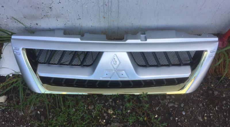 Хромирование деталей автомобиля - решетка с эмблемой Митсубиси